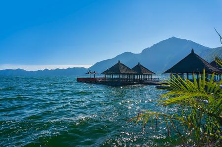 bali: floating restaurant at batur lake, bali indonesia