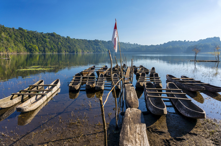 indonesia: traditional boat park at tamblingan lake, bali island indonesia