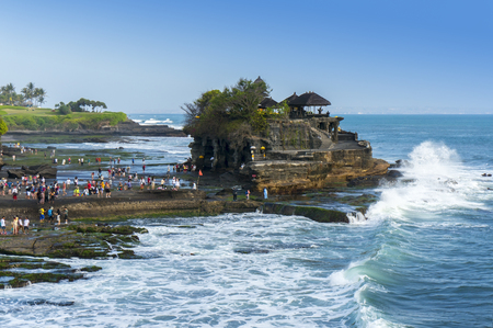 lot of: tanah lot is very popular destination for tourist at bali island indonesia Stock Photo