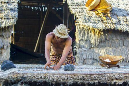 Traditional salt farmer at kusambar bali island, indonesia