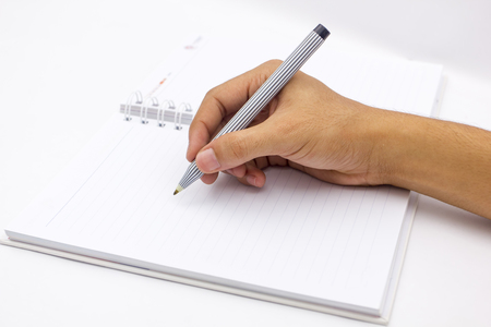 writes: hand writing the blank notepad Stock Photo