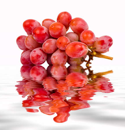 seedless: seedless red grape on isolated background with water reflection