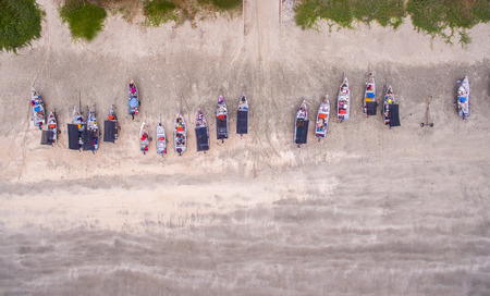 beach view: aerial view fishing boat park at beach during low tide