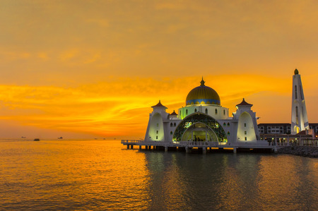 great sunset and floating mosque at selat malacca, malaysia