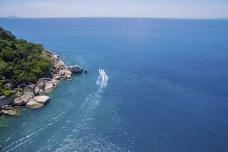 great barrier reef: amazing aerial view sea and speed boat with vibrant blue