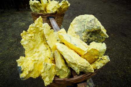 raw yellow sulfur in the basket Фото со стока - 79404110