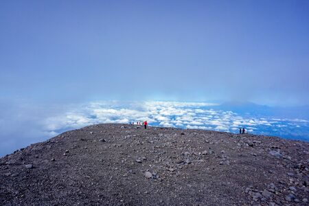 Semeru mount hikers with blue sky