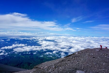 Semeru mount hikers at summit with blue sky