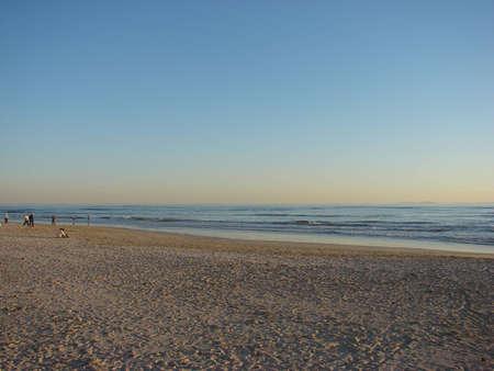 blu sky: Blu Sky and orange light as the sun sets on the beach