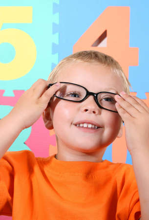 Blond toddler playing with adult black-rimmed glasses Stock Photo - 2507817