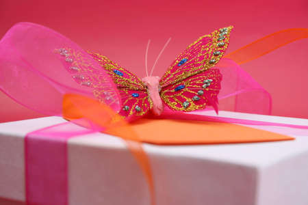 Pink butterfly on a white gift box as a decoration Stock Photo - 2797625