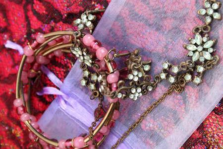 green gemstone: Green gemstone necklace on a small organza bag
