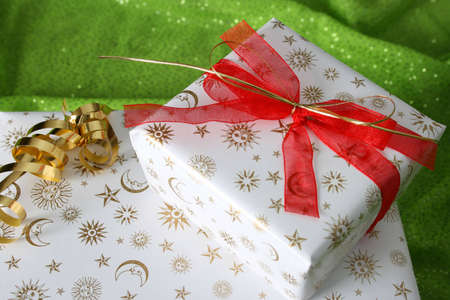 beautifully wrapped: Beautifully wrapped christmas gifts on a green background