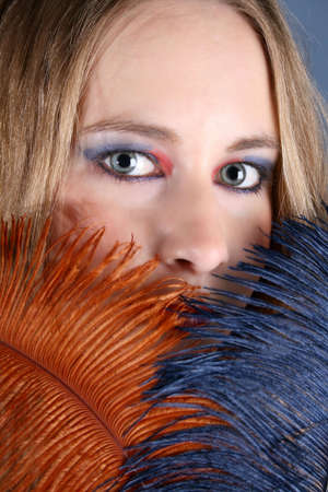 Beautiful female model with blue eyes and weird make-up Stock Photo - 3859884