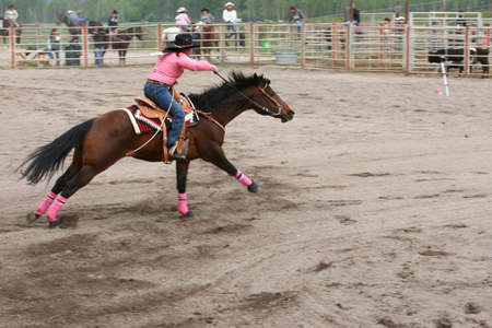 MERRITT, B.C. CANADA - MAY 22nd: Cowgirl barrel racing event at the Richest Indian Rodeo May 22, 2010 in Merritt British Columbia, Canada