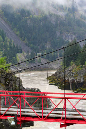 fraser river: Suspension Bridge crossing the Frazer Canyon in Canada Stock Photo