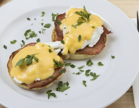 unbroken: Making eggs benedict requires careful orchestration  You have to have warm, bacon, hot buttered toasted English muffins, bacon to your desire, and a warm, creamy, unbroken Hollandaise sauce, all at about the same time