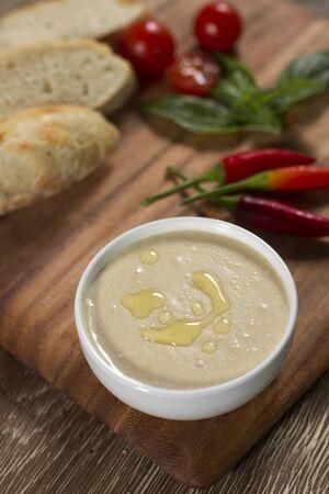 humus: Humus in white bowl with red peper and  cherry tomato
