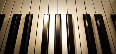Top view close up shot of piano keyboard with spot light on Stock Photo