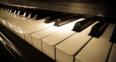 keyboard key: Close up shot of piano keyboard with spot light on