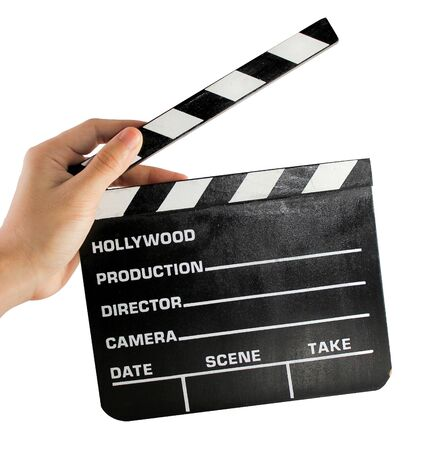 A hand holding a clapper board