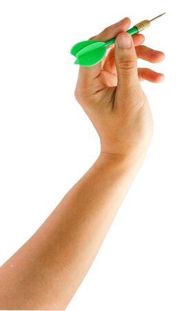A hand holding a yellow dart