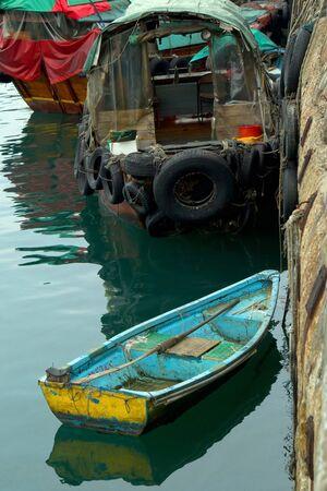 A Sampan and Boats parking in Hong Kong typhoon shelter Stock Photo