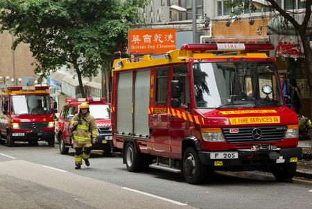 HONG KONG - May 02: Firemen and fire trucks arrive Chai Wan in morning on May 02, 2011 in Chai Wan, Hong Kong, China. A 19-year-old woman died and three people were injured in the fire.