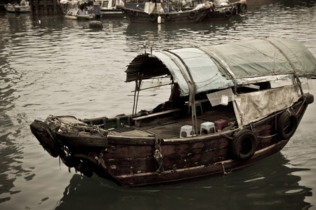 A Sampan boat floating in the sea in Hong Kong Typhoon Shelter Stock Photo