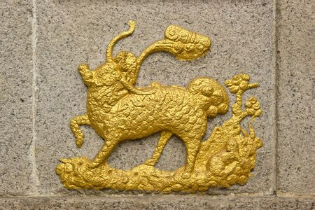 Chinese Unicorn(Qilin) totem on a Chinese Temple wall, Chinese Unicorn is a kid of dragon and phoenix. It is symbolic of healthy, good luck and happiness. photo