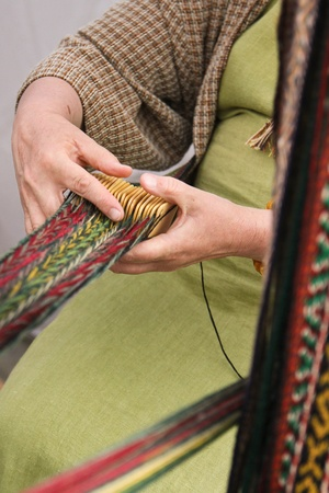 Woman crocheting pattern stripes with traditional tool Stock Photo
