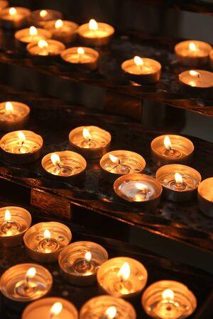 Church candles lighting in dark environment
