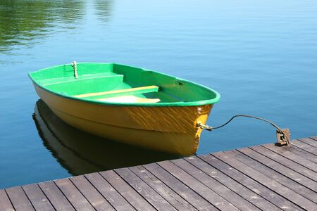 seaview: A small boat parking at a wood dock