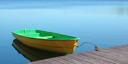 skiff: A small boat parking at a wood dock