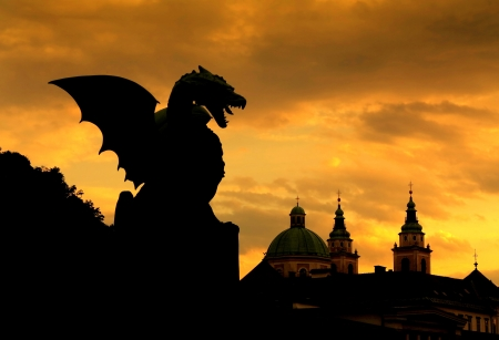 Sunset scene of Green Dragon on the Dragon Bridge in capital city Ljubljana, Slovenia  The Dragon Bridge was erected in 1901  photo