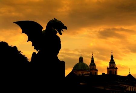 Sunset scene of Green Dragon on the Dragon Bridge in capital city Ljubljana, Slovenia  The Dragon Bridge was erected in 1901  Stock Photo