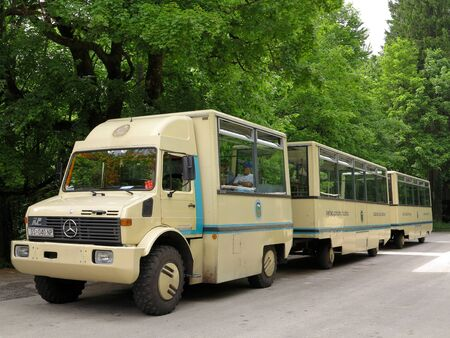 Croatia-MAY 21 Bus tour is ready to start at Plitvice National Park on May 21,2012 in Croatia  Bus tours set off regularly everyday at the entrance of the Plitvice National Park  This kind of buses is specially designed for touring in a forest where there