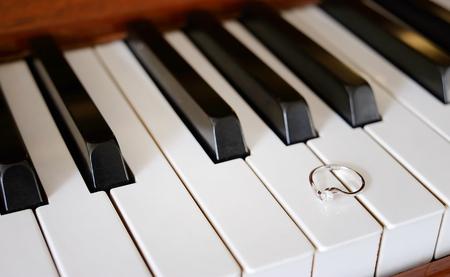 A pretty diamond ring on a piano