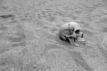 Skeleton remains  buried in the sand Stock Photo