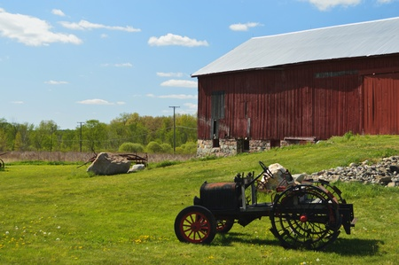 Antique country side with barn and tractor