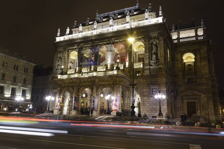 Traffic flow in front of illuminated opera in Budapest, Hungary