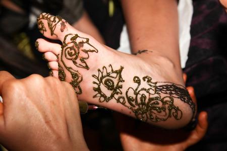 feet with henna design Stock Photo