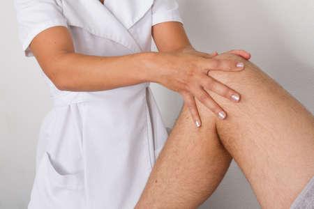 tuina: knee massage Stock Photo