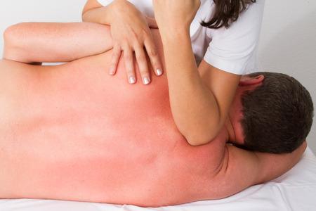 tuina: massage with elbows Stock Photo