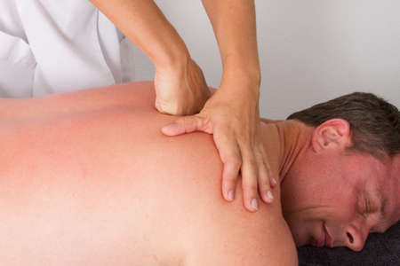 tuina: massage with fists on the back