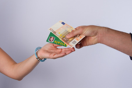 doctor money: Gives Patient health card and money to the doctor Stock Photo