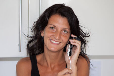 brune: woman on the phone Stock Photo