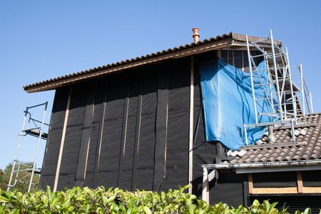 tarpaulin: House with tarpaulin