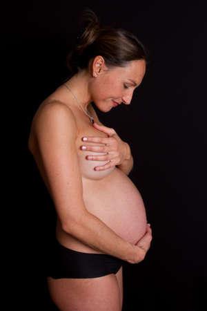 joyfull: Pregnant and joyfull woman Stock Photo