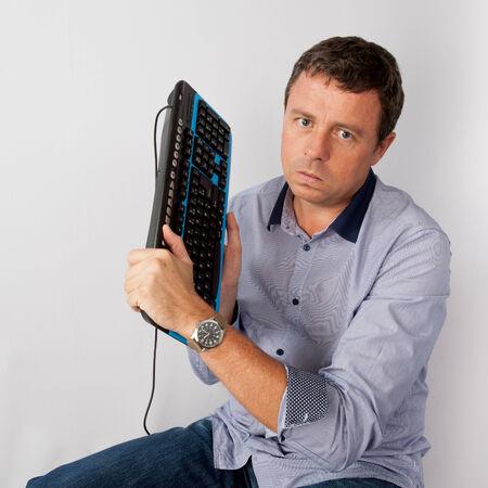 ou: Desperate man sitting ou his computer